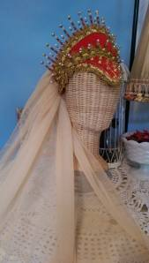 The embellished headpiece.